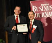 David Manuchia accepting an Ultimate Newcomer award for Restaurant Partners Inc.