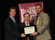 Eric Dore and Shane McGuiness accepting an Ultimate Newcomer award for Sunshine Fitness Management