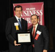 Lawrence Hefler accepting an Ultimate Newcomer award for BlueChip Energy LLC