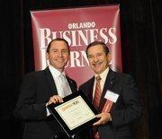 Joe Nunziata accepting an Ultimate Newcomer award for FBC Mortgage LLC.