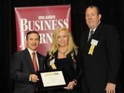 Cheryl Walker Waysonand Drake Wayson accepting an Ultimate Newcomer award for General Projection Systems Inc.