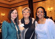 from left: Claire Fournier of Orlando Health, Cheryl Belfay of Ad Tangibles and Kena Lewis of Orlando Health meet before the start of the awards event.