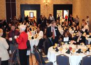 Guests find their tables as the doors open to the awards event ballroom.