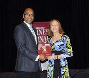 Jeanette Gessie of DiCom Software accepts the first award in the small company category for Healthiest Employer.