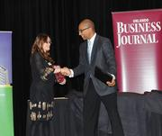 Stephanie Watkins of Moss, Krusick & Associates, LLC accepts the top award in the small company category for Healthiest Employer.
