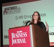 Stephanie Watkins of Moss, Krusick & Associates, LLC addresses the audience after accepting the top award in the small company category for Healthiest Employer.