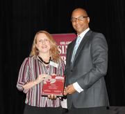 Jennifer Addleman of Rollins College accepts the first award in the medium company category.