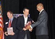 Doug Irmscherof Duke Realty accepts the top award in the medium company category.