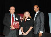 David Bundy and Joan Marie White of the Children's Home Societyaccept the first award in the large company category.