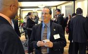 Carlos Palenzuela of Smart City Telecom takes some time to network before the start of the awards event.
