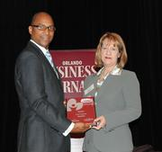 Kim Watson of Metro PCS accepts the second award in the large company category.