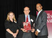 David Bundy and Joan Marie White of the Children's Home Societyaccept the top award in the large company category.