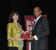 Nancy Dinon of Orlando Health accepts the first award in the giant company category.