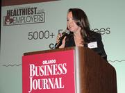 Kristen Duquaine says a few words after accepting Florida Hospital's top award in the giant company category.