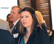 Heather Phiel of the Hylant Group talks with other guests before the awards event.