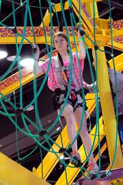 A young adventurer prepares for a walk across a rope bridge, high above the IAAPA exhibitor floor. The attraction, by Ropes Courses Inc. is an annual must-see at the convention.