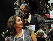 An IAAPA guest gets a surprise from one of the animatronic features made by Scarefactory Inc. at its company exhibit area.
