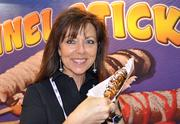 Tomi Newberry of Funnel Sticks shows off her company's creation, which is literally funnel cake on a stick. If chocolate-coated fried dough can't put a smile on your face, nothing can.