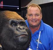 Curtis Henry of Orlando-based Florida Creative Industries poses with a staff member at his company's booth at IAAPA 2012.