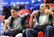 From left: Brazilian theme park owners Mauricio Meneses and Vanderlei Salumoni seem apprehensive as they prepare to take a spin on the Air Race by the Zamperla company.