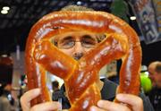 Bill Robilio of J&J Snack Foods Corp. shows off a giant pretzel at the company's stand.