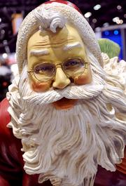 He sees you at IAAPA. Santa sculptures adorned the Winterland Inc. exhibitor booth.