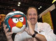 Dino Rentos, owner of Winter Park-based design company The Prop Magician, holds an Angry Bird prop his company made for a recent Philadelphia Eagles halftime show. Rentos' company was attending its first IAAPA convention.
