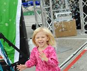 Three-year-old Lana Paci chases bubbles from a machine in the outdoor exhibit area. This face is what IAAPA is all about.