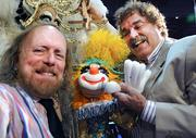 From left: Marionette maker Bob Kramer and puppeteer Doug Feltch strike a pose at Bob Kramer's Marionettes booth. Their company has made handcrafted puppets for the entertainment industry for 50 years.