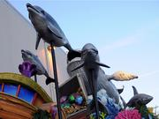 Dolphins and whales decorate an undersea-themed float.