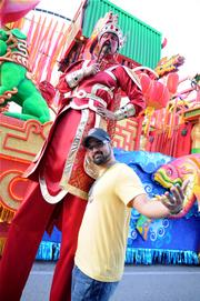 OBJ Reporter Richard Bilbao strikes a pose with a stilt walker by the Chinese New Year float.