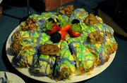 Dessert! Can't forget dessert. The King Cake and pralines went fast. Work, work, work.