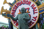 A likeness of Jazz great Louis Armstrong graces a music themed float.