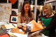 Sarah Eckler (left), with Townsend Leather, shows samples of seat leather.