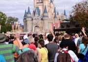 For some reason, everyone started waving. They were either trying to get on TV or heat stroke set in and everyone thought they were princesses.