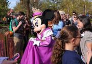 Princess Minnie makes her way through the crowd. What's really cute is how that girl's iPhone cover matches her outfit.
