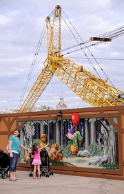 Cranes and crews continue working on the next phase of new Fantasyland, the Seven Dwarfs Mine Train, opening in 2014.