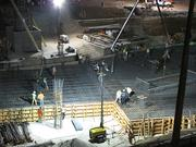 A 100-man construction crew spent eight hours Dec. 14 laying 2,400 cubic yards of concrete.