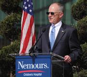Roger Oxendale,senior vice president of Nemours andCEO of Nemours Children's Hospital Orlando, addresses the crowd during the dedication ceremony.