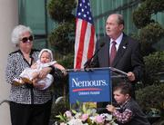 Nemours Chairman John Lord addresses the crowd with his wife Carolyn and grandchildren, Jonathan and Elizabeth.