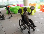 A patio area by the surgery center features colorful seating and whimsical statues.