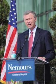 Dr. David Bailey, president and CEO of Nemours Children's Hospital, addresses the crowd during the dedication ceremony.