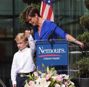 """Lori Paul of the Nemours Family Advisory Council introduces her son Max who suffers from cystic fibrosis. """"He is the reason I'm here,"""" she said as she addressed the crowd during the dedication ceremony."""