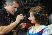 Evan Moore adds the finishing touches to Jessica Torgas' new Who look.