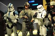 A volunteer wearing immersive military training gear gets his photo taken with his science fiction counterparts, as members of the 501st Star Wars costume club were onhand at Otronicon.