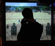 The target range features a digital display that works in tandem with a hand held weapons system.