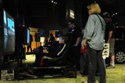 Guests wait their turn to try some pilot training simulation technology by Lockheed Martin.