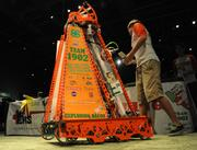 The 4-H robotics team, named Exploding Bacon, shows off its remote control creation capable of playing basketball.