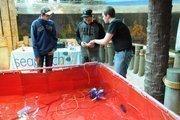 Otronicon guests get a quick leson in piloting the Sea Perch, a remote controlled submarine.