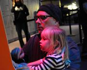 Peter Olsen of Orlando introduces his daughter, Laila, to the wonders of Donkey Kong thanks to Otronicon.